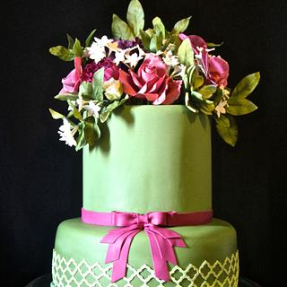 Green cake and sugar flowers