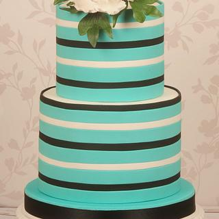 Striped cake with a white peony
