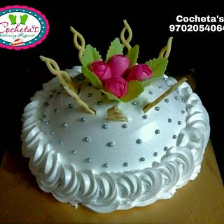 Whipped cream cake with water paper flowers
