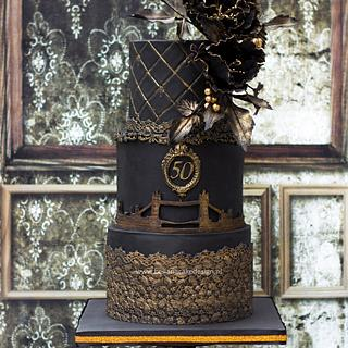 Black and bronze London themed birthday cake