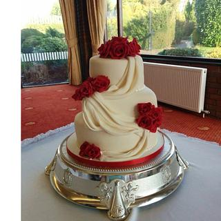 Rose and swag wedding cake