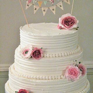 Rustic wedding cake with handmade bunting.