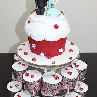 Cupcake shaped cake with to-be bride ad groom figures