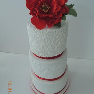 Peony, balls and stencil wedding cake