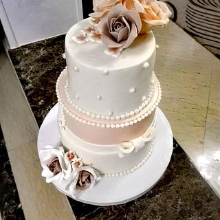 Ivory and coral engagement cake