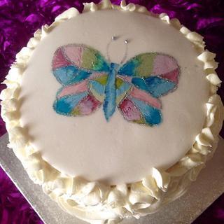 Hand painted butterfly rainbow birthday cake