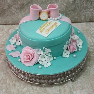Light blue cake with pink roses
