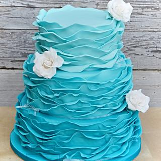 Turquoise wedding cake with white roses