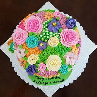 Whipping icing flowers  - Cake by Niyati