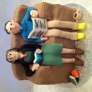 Couple on sofa anniversary cake
