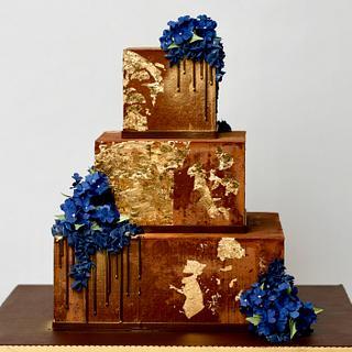 Gold and chocolate birthday cake