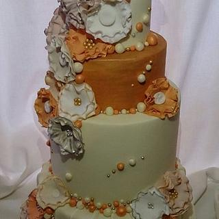 cream gold and peach tiered wedding cake