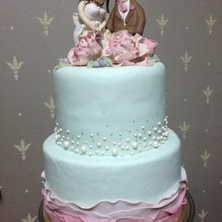 tiffany green and dusty rose wedding couple cake