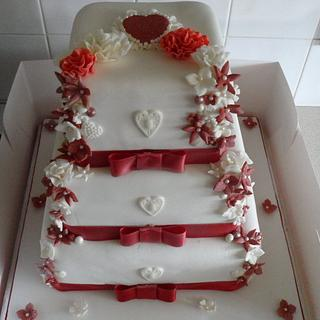 FLOWERY RED WEDDING CAKE