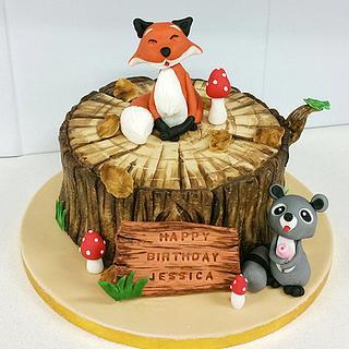Fox on a tree stump and raccoon birthday cake