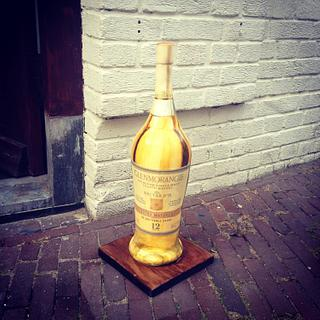 Painted standing whisky bottle cake