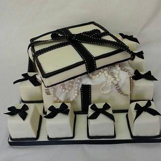 Links of London style box cake with mini cakes