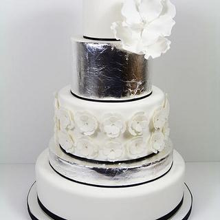 Silver leaf and magnolia wedding cake