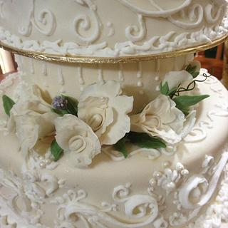 Wedding cake with fondant flowers and scrolls