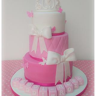 Pink tiara cake with bows.