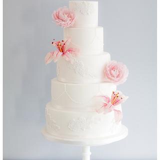 Romantic lilies and peonies wedding cake