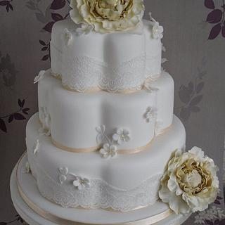 Vintage lace and blossoms wedding cake