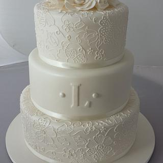 3 teir wedding cake with free hand piping.