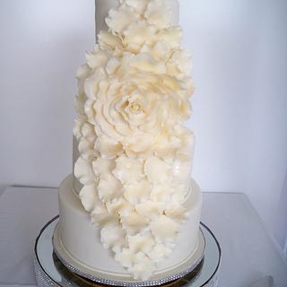 Elegant cascading rose wedding cake