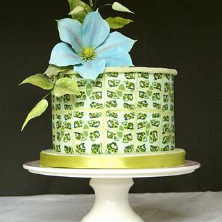 Green cake and blue clematis