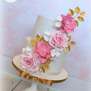 Pretty pink and gold floral cake