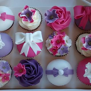 Pink & purple flowers & bows birthday cupcakes  - Cake by Kerri's Cakes