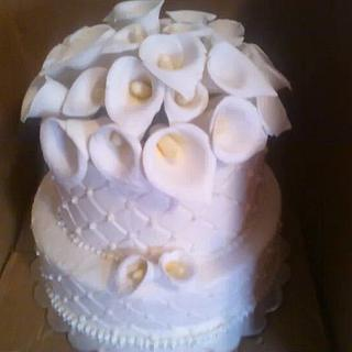 Wedding cake with calle lilly topper