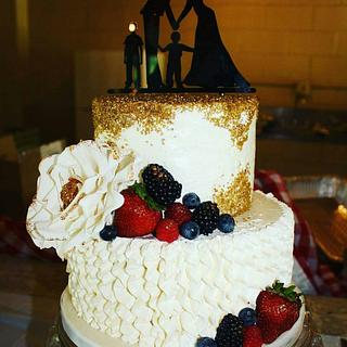 A gold berries and cream wedding cake