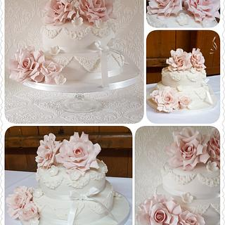White with a touch of pink wedding cake