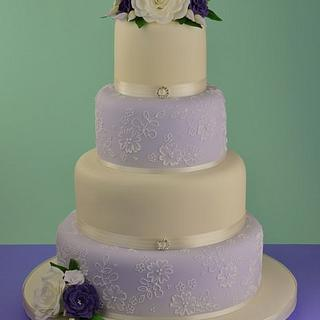 Lilac and Ivory piped lace and sugar flowers wedding cake.