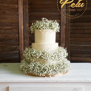 Wedding cake with babys breath