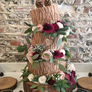 Topsy turvy rustic wedding cake