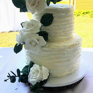 Rustic wedding cake with sugar roses