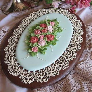 Royal icing cookie lace and roses