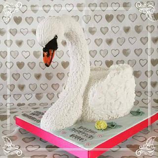 Large realistic swan cake .