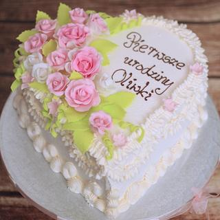 cake decorated with cream and sugar roses