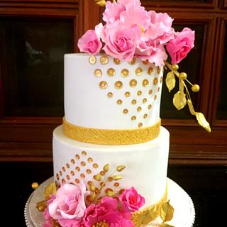 White cake with gold sequins,pink peonies and roses