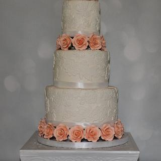 Lace and peach roses