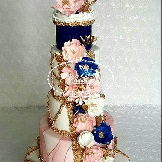 Floral wedding cake in blue and pink