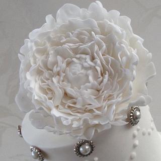 White peony cake on raindrop crystal stand