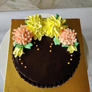 Truffle with whipped cream flowers - Cake by Varsha Bhargava