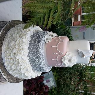 Ruffles and pearls wedding cake
