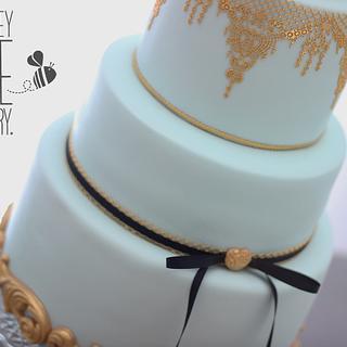 Powder blue & Gold Wedding Cake by The Honey Bee Cakery