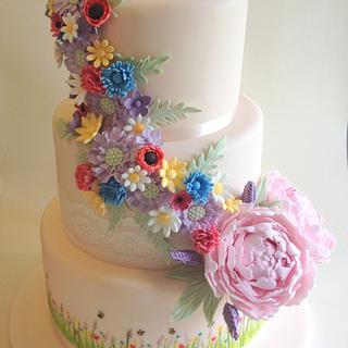 Meadow flowers and peonies wedding cake