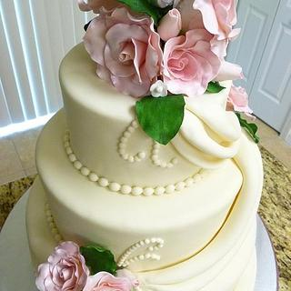 Delicate Beige with pink roses wedding cake